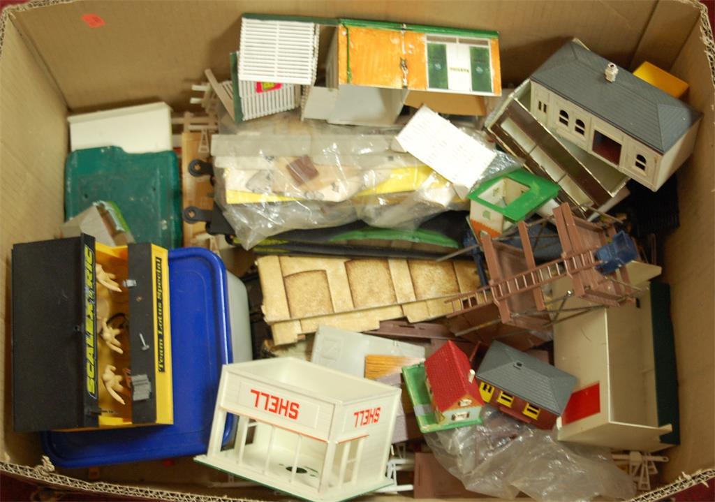 A box of assorted plastic kit built model buildings etc