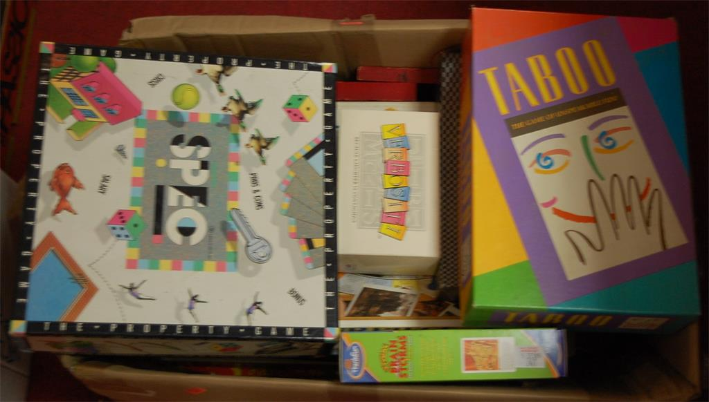 A box of assorted children's toys and games to include Masterpiece, Verbosity, Taboo, etc