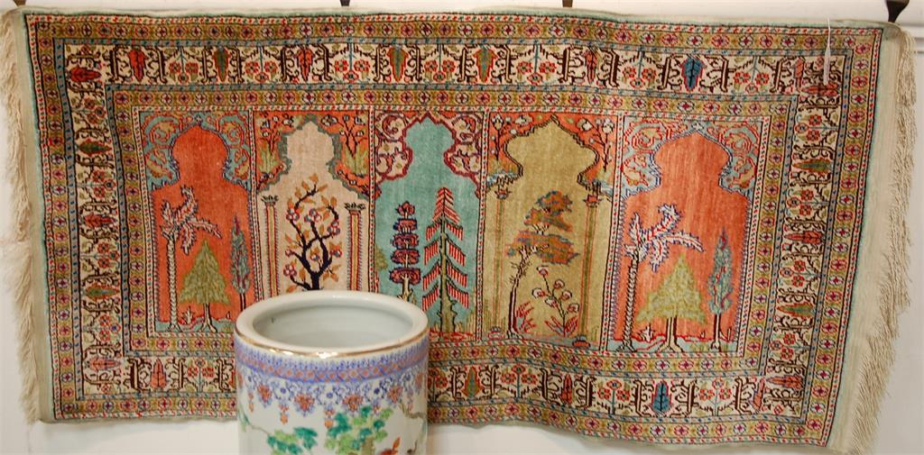 A small Persian machine woven prayer rug