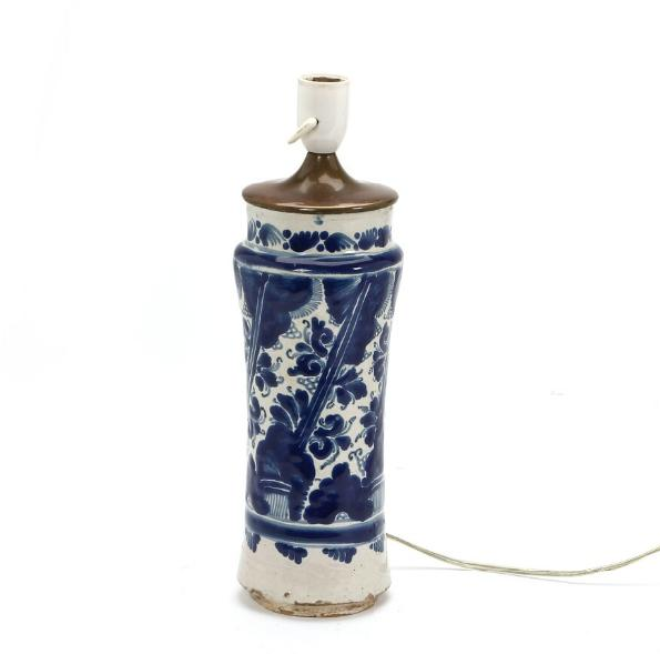 An Italian 18th century faience albarello decorated in blue with stylised leaves