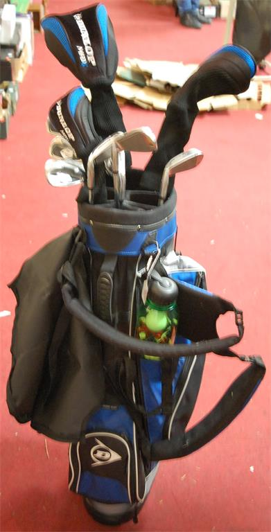 A collection of various Dunlop Max golf clubs and bag