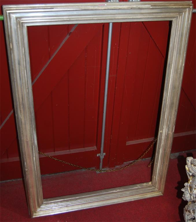 A silvered and moulded rectangular picture frame