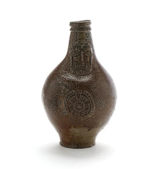 An 18th/19th century glazed fired clay jug