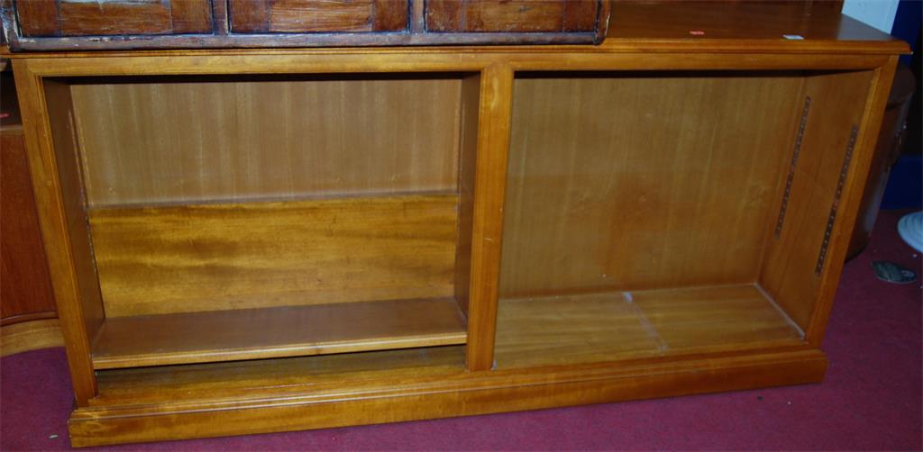 A contemporary beech freestanding open bookshelf