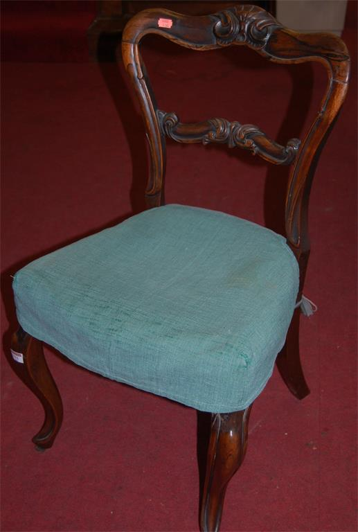 A pair of early Victorian rosewood balloon back salon chairs