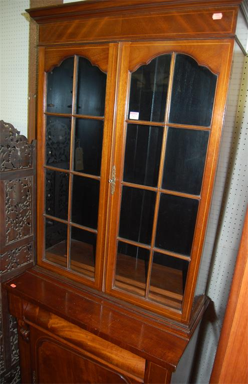 A Victorian mahogany and satinwood strung bookcase cupboard having twin door glazed upper section (associated)