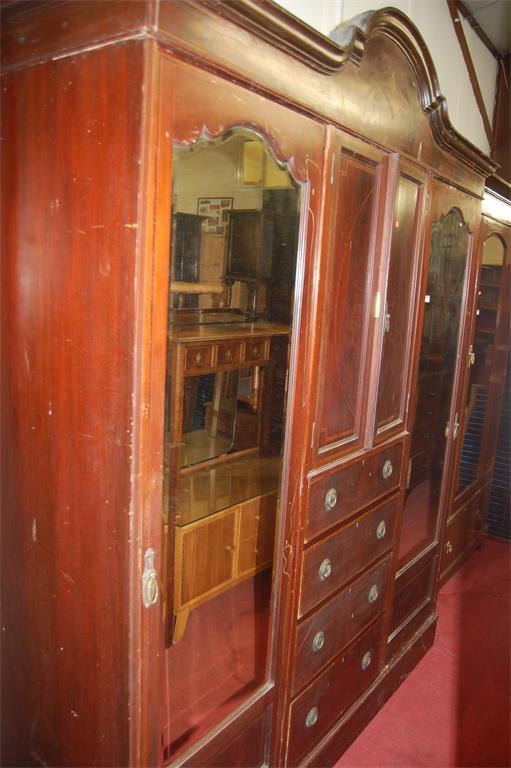 An Edwardian mahogany and rosewood inlaid triple wardrobe