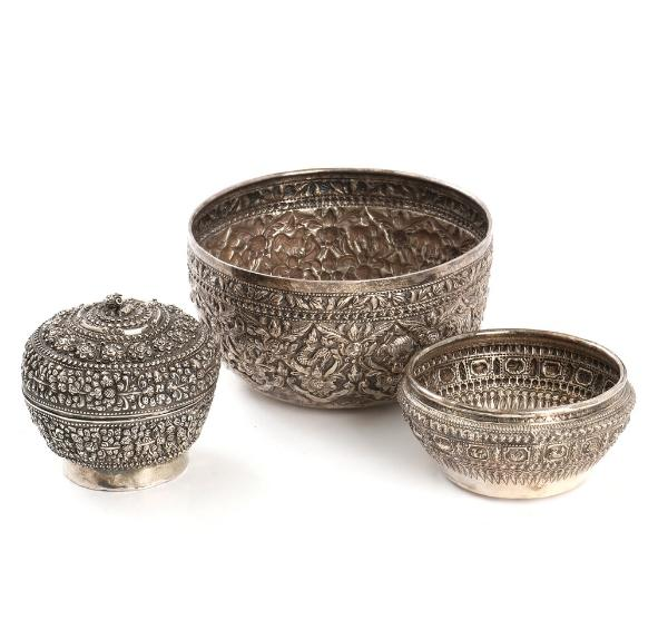 A lidded Persian silver bowl and two bowls