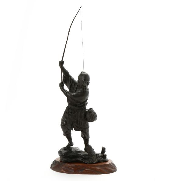 Japanese figure of brown patinated bronze of fisherman with his catch