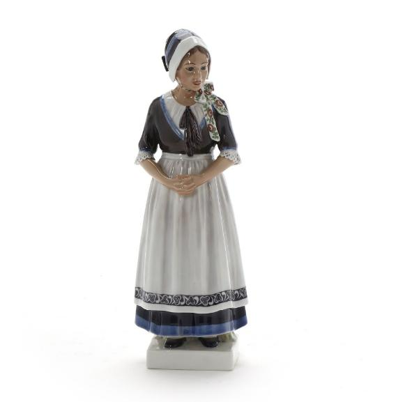 """""""Girl from Hedebo"""". A porcelain figure decorated in underglaze colours. 1142. Dahl-Jensen"""