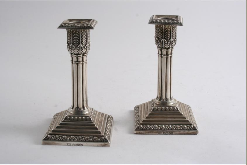 A PAIR OF VICTORIAN DWARF CANDLESTICKS