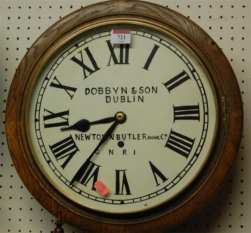 A circular oak wall clock, having repainted dial for Dobbyn & Son, Dublin