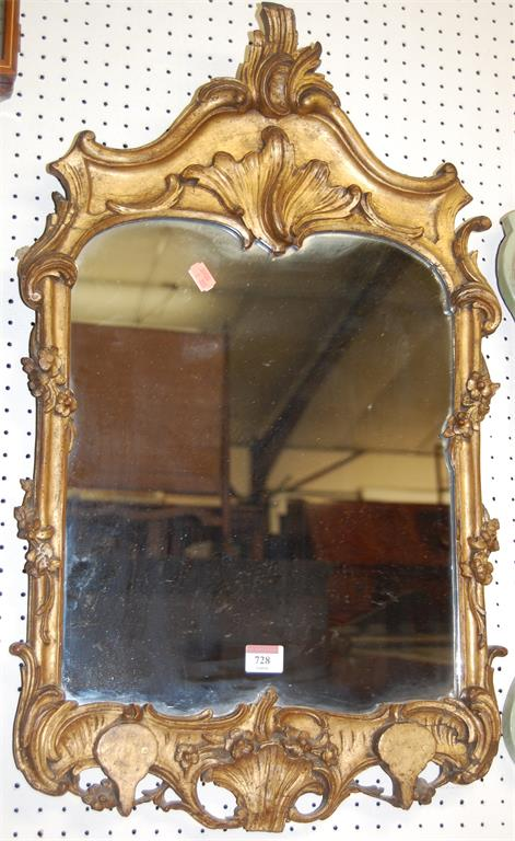 A 19th century Rococo Revival floral carved giltwood wall mirror