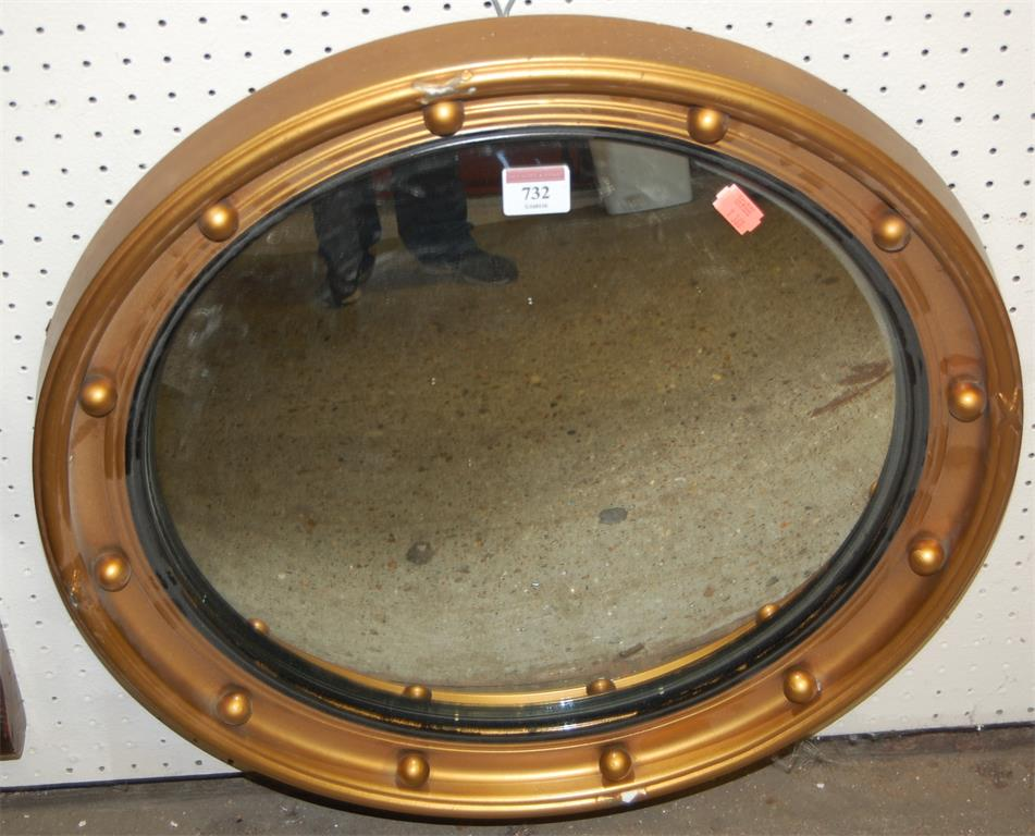 A Regency style gilt decorated convex circular wall mirror