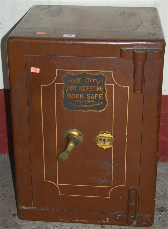 An early 20th century cast iron floor safe, made in Birmingham, with key