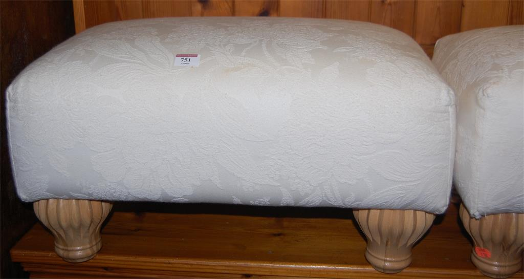 A pair of modern cream floral upholstered low footstools