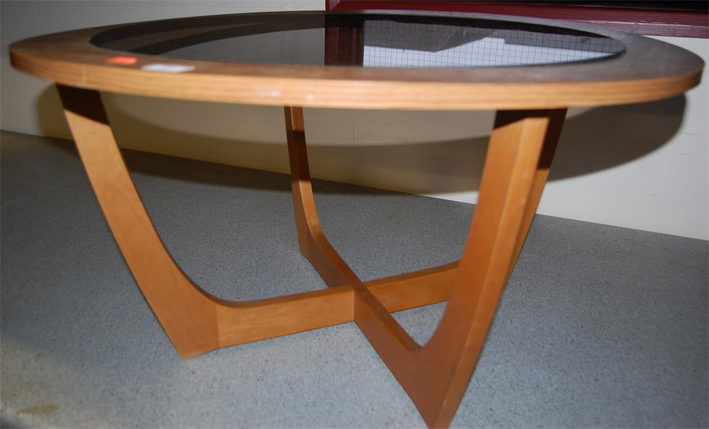 A 1970s G-Plan teak circular glass inset occasional table