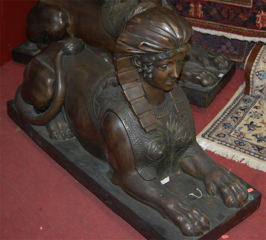 A pair of large contemporary Egyptian style bronze models of Sphinxes