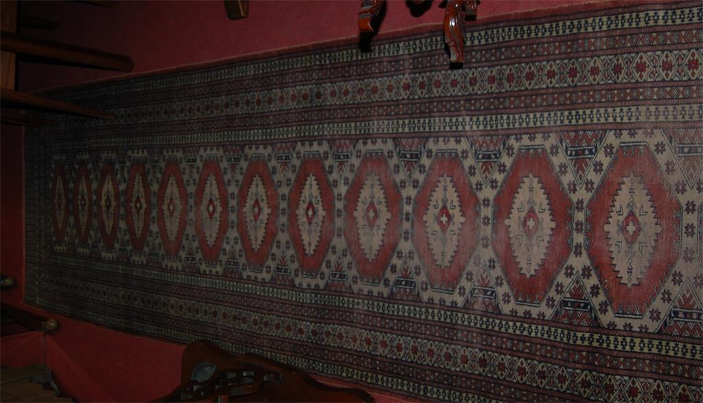 A Persian woollen hall runner (worn)