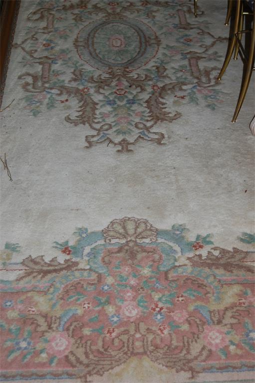 A Persian style woollen carpet, having a cream ground
