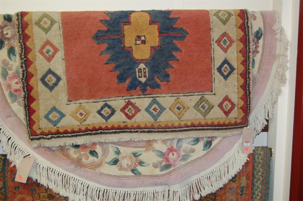 A Chinese Superwash circular rug; and a Caucasian woollen rug