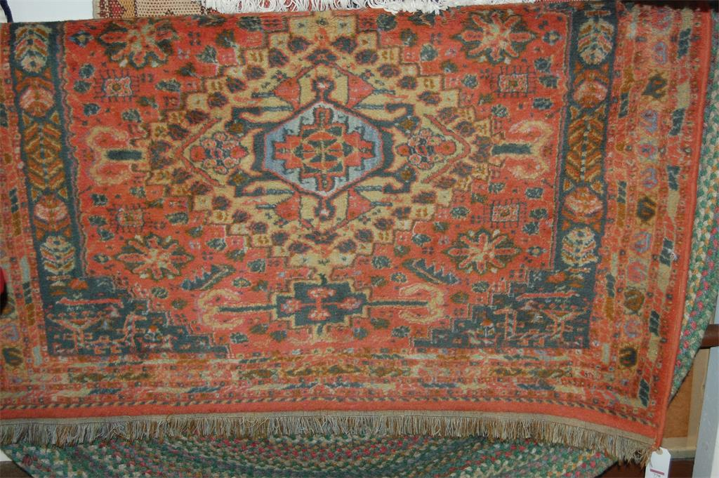 A Persian style machine woven woollen rug; and one other hand-knotted European oval rug