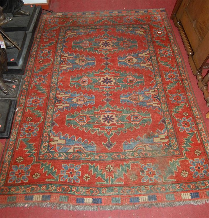 A Turkish woollen red ground rug