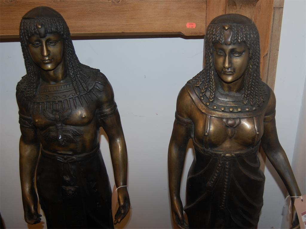 A pair of contemporary Egyptian style bronze standing figures of a Pharaoh