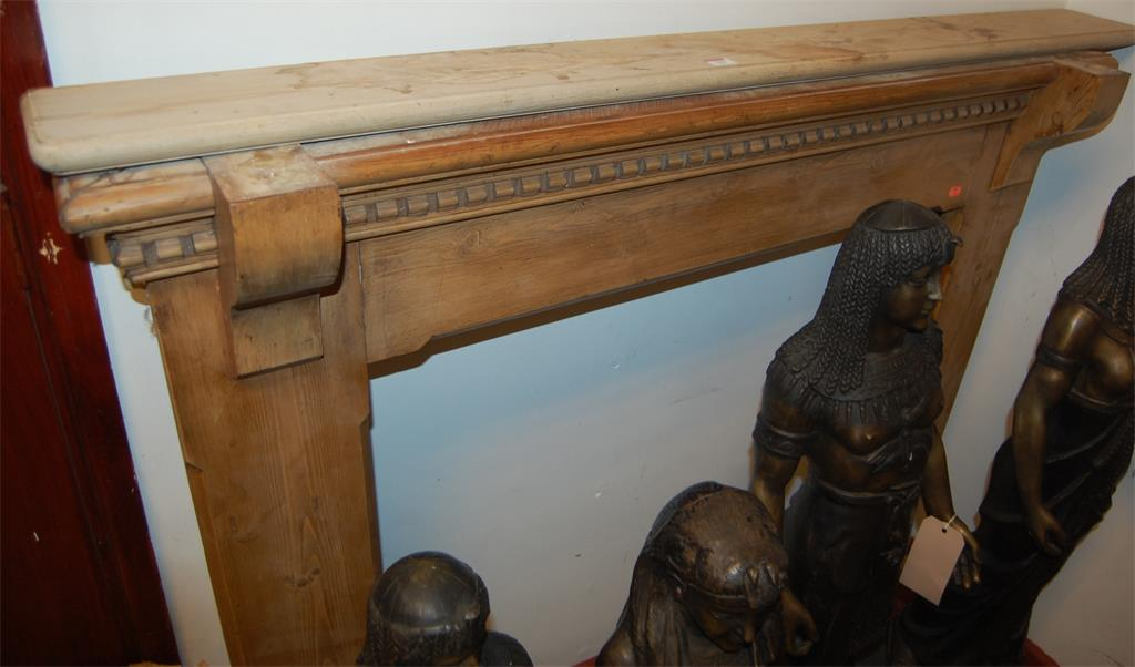 A Victorian pine fire surround; together with another similar