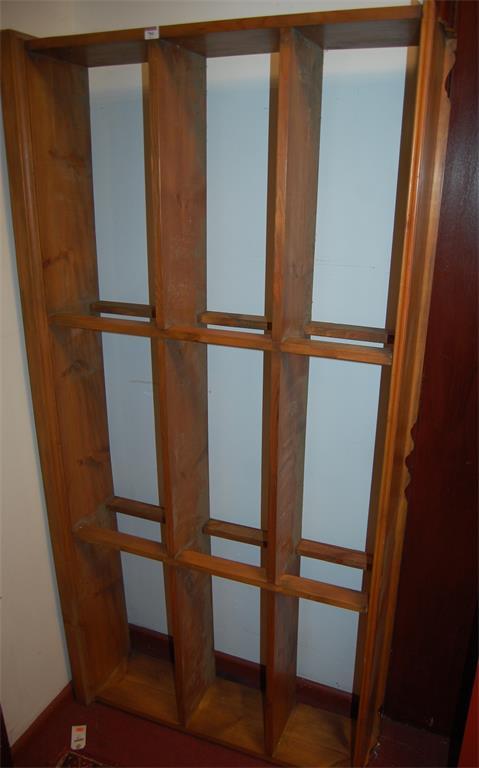 A pine freestanding open bookshelf