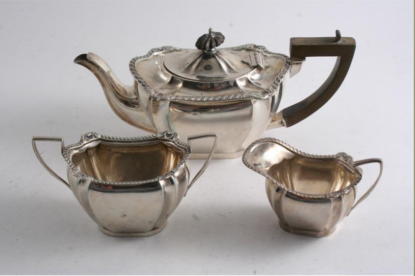 AN EDWARDIAN SMALL THREE PIECE TEA SET