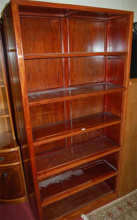 A set of three contemporary Chinese hardwood freestanding open bookshelves