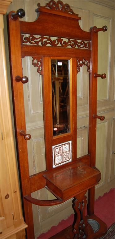 A late Victorian mahogany mirror inset hall-stand