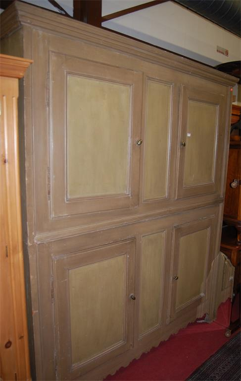 An extremely large painted and reclaimed pine four door pantry cupboard