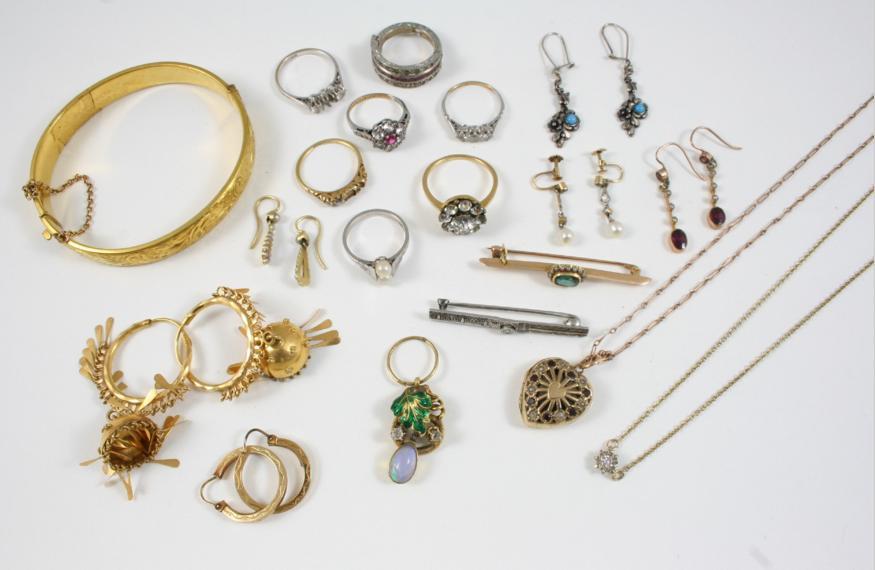 a pair of gold hoop earrings