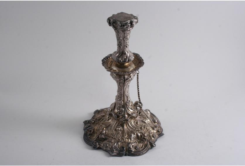 A LATE 19TH CENTURY CONTINENTAL EMBOSSED CANDLESTICK