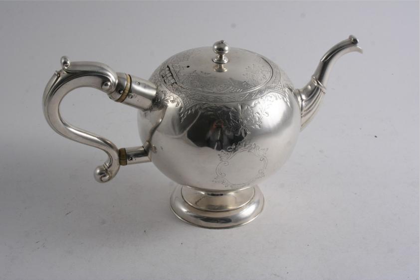 A GEORGE II SCOTTISH BULLET TEA POT