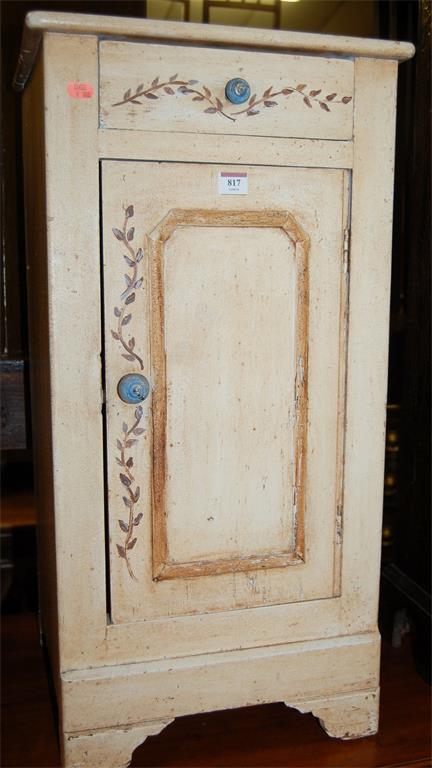 A floral painted pine single door bedside cupboard, having single upper drawer
