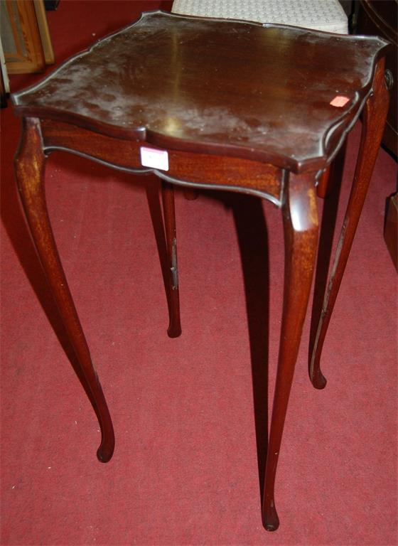 A mahogany shaped top occasional table on cabriole supports