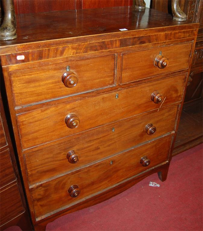 A mid 19th century mahogany and satinwood strung chest of two short over three long drawers