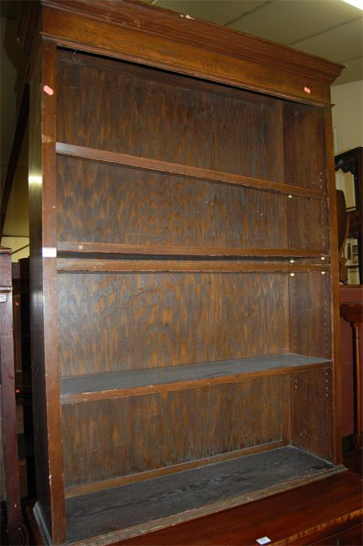 A mid-20th century oak freestanding open bookshelf (formally the upper section of a bookcase cupboard)