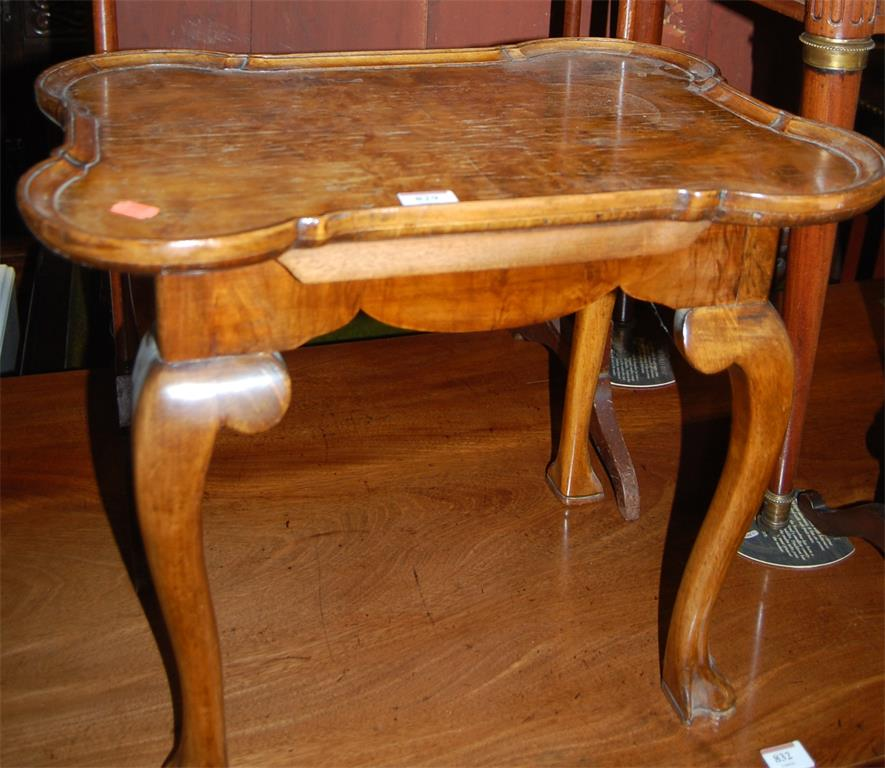 A figured walnut shaped top low occasional table (top removable)