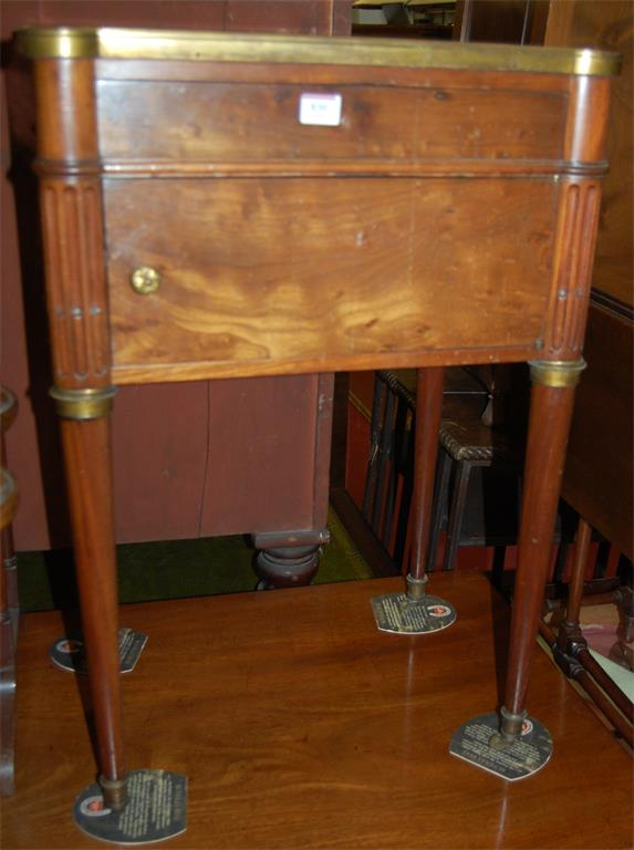 A late 19th century French walnut and slate topped bedside cupboard