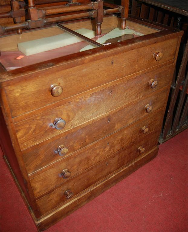 A 19th century mahogany hinged and glazed top shop display chest, having four long drawers