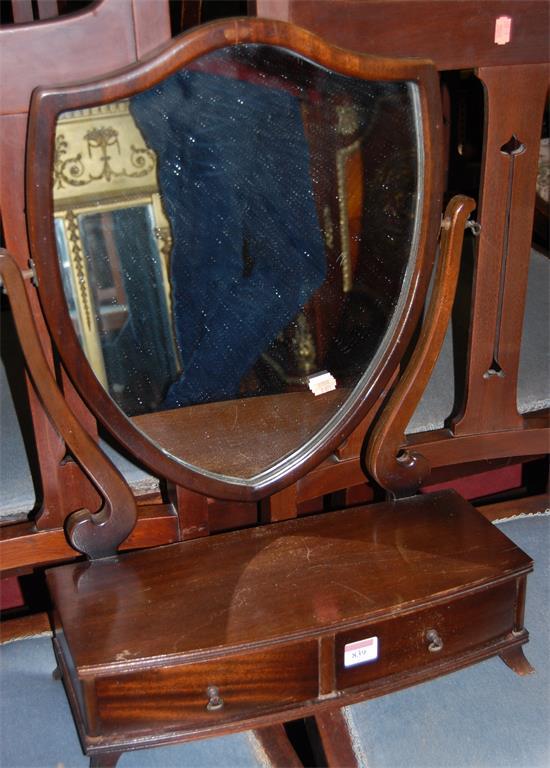 A reproduction mahogany shield shaped bowfront dressing table mirror