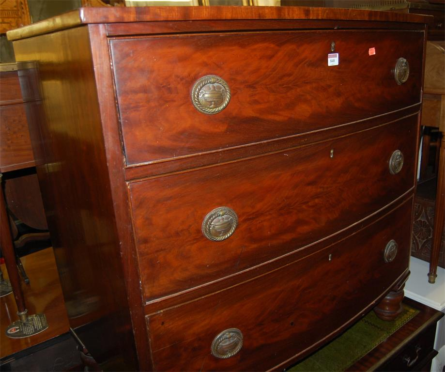 A mid-19th century flame mahogany bowfront chest of three long drawers