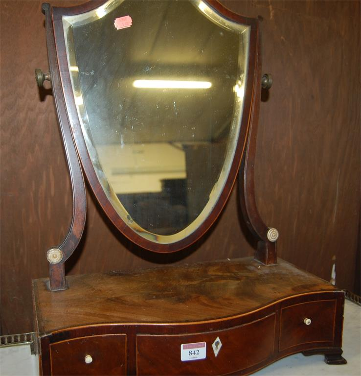 A 19th century mahogany and satinwood strung shield shaped dressing table mirror