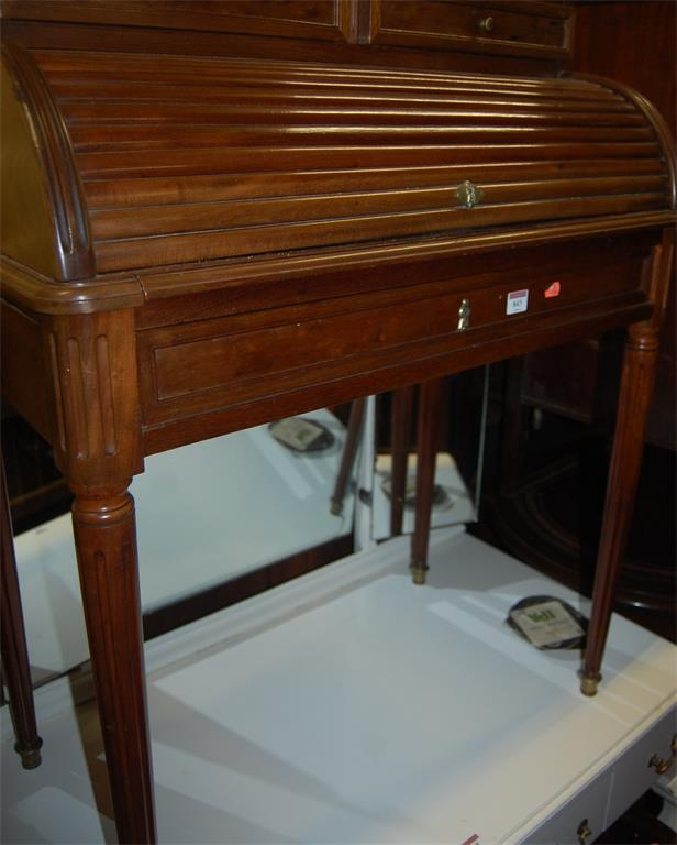 A circa 1900 French walnut cylinder writing desk raised on fluted and tapering supports