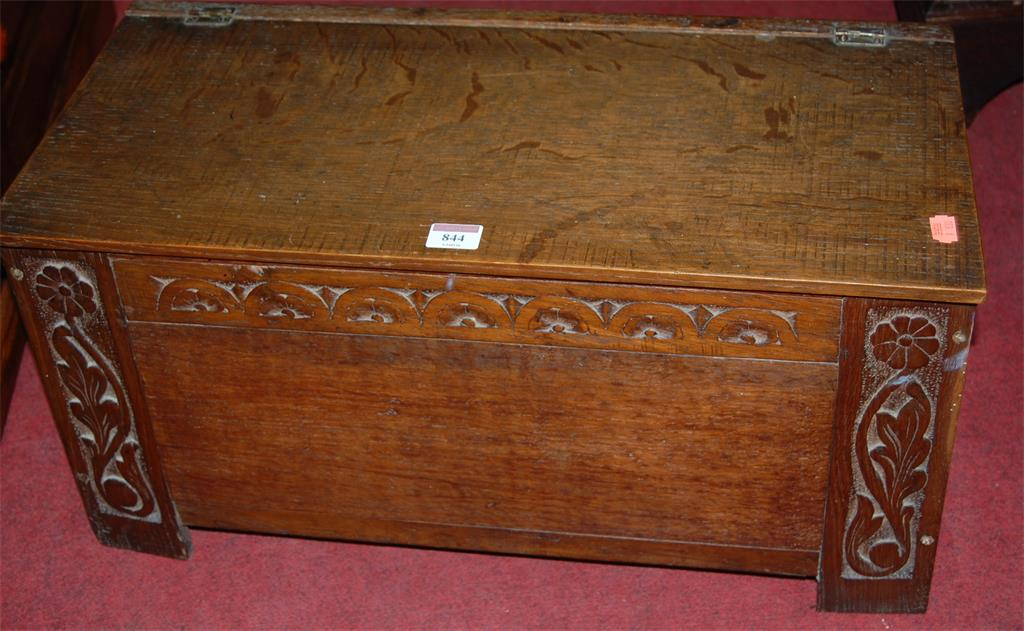 An antique low relief carved and joined oak hinge-top chest of small proportions
