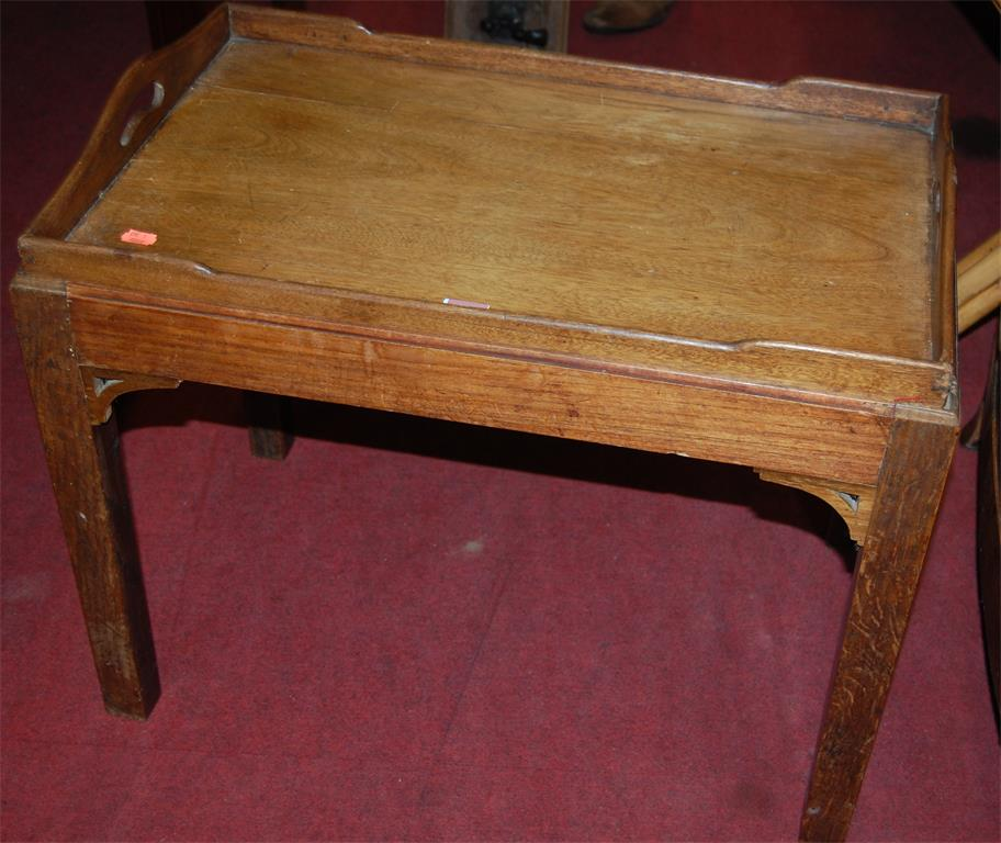 A mahogany twin handled butlers tray on stand